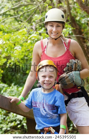 Family enjoying a Zip line Adventure on Vacation - stock photo