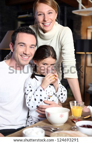 Family enjoying breakfast together - stock photo