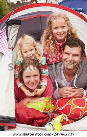 Family Enjoying Camping Holiday On Campsite  - stock photo