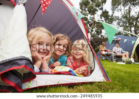 Family Enjoying Camping Holiday On Campsite