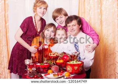 Family Enjoying Christmas Meal At Home - stock photo