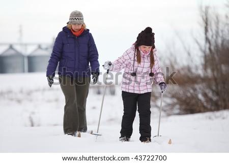 Family enjoying cross-country skiing - stock photo