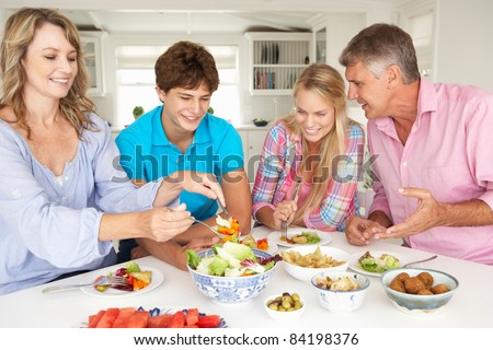 Family enjoying meal at home - stock photo