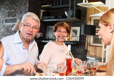 Family enjoying meal together - stock photo
