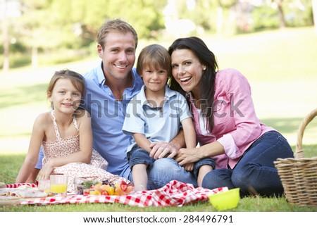 Family Enjoying Picnic Together - stock photo