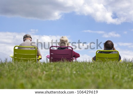 Family enjoying recreation - relaxing in the park against a clear blue sky.