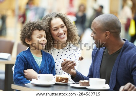 Family Enjoying Snack In Caf\x81_ Together - stock photo