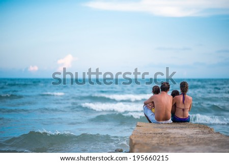 Family enjoying the view of the sea