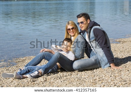 Family enjoying their time at the beach