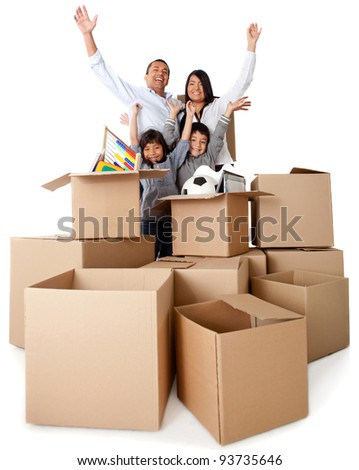 Family excited about moving with arms up and cardboard boxes - stock photo