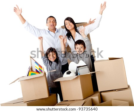 Family excited moving house packing in cardboard boxes â?? isolated - stock photo