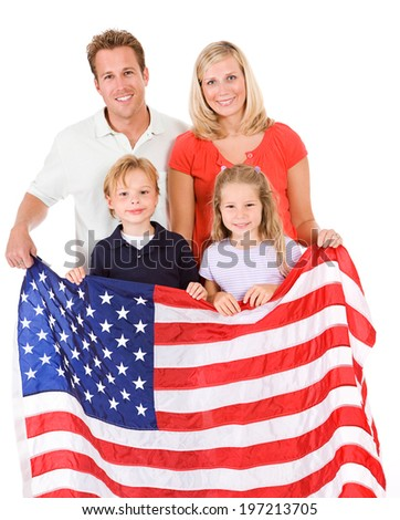 Family: Family Of Four Holding American Flag - stock photo