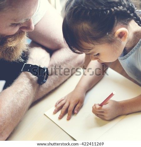 Family Father Daughter Love Parenting Teaching Drawing Togetherness Concept - stock photo