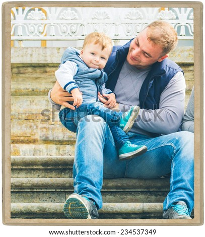 Family father with child in park walking in same clothes textile jeans jacket on step - stock photo