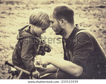family father with son black and white - stock photo