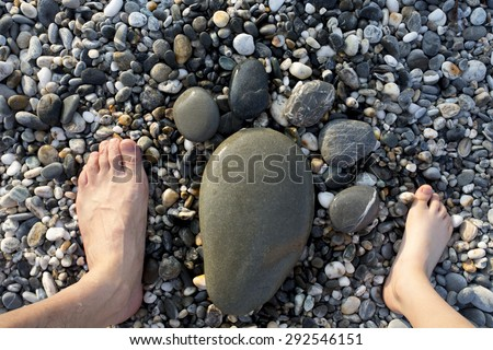 family feet and feet by Pebble,happy and nice view,china - stock photo