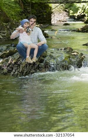 Family fishing - stock photo