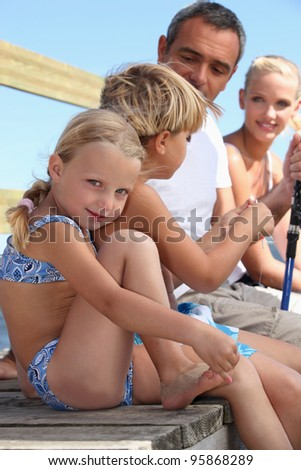 Family fishing during a nice Sunday afternoon. - stock photo