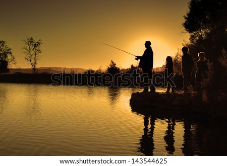 family fishing silhouette - stock photo