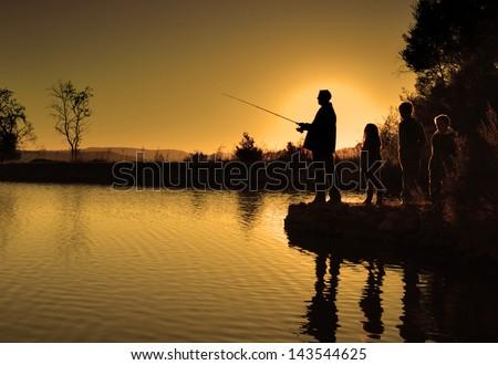 family fishing silhouette - stock photo