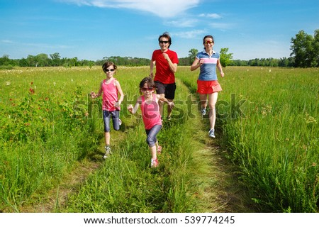 Family fitness outdoors, parents with kids jogging in park, running and healthy lifestyle