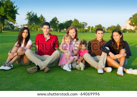 family friends group people sitting green grass outdoor with children - stock photo