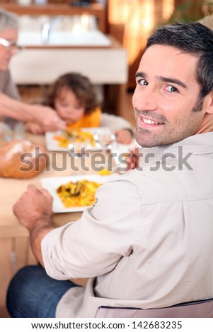 Family gathered around kitchen table