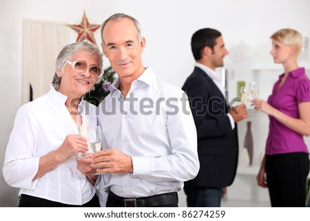 family gathering at new year's eve - stock photo