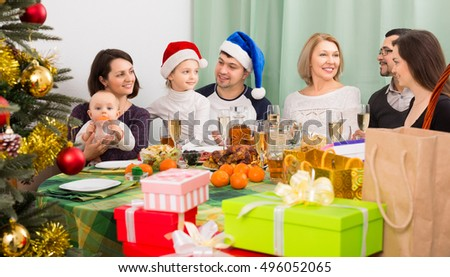 family gathering together for Christmas celebration at home