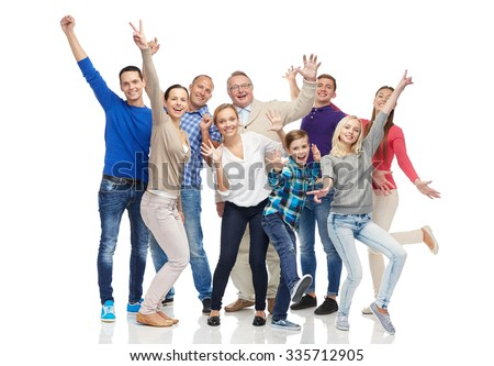 family, gender, generation and people concept - group of smiling men, women and boy having fun and waving hands - stock photo