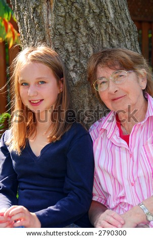 Family generations - portrait of granddaugher and grandmother - stock photo