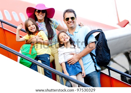 Family going on a trip traveling by airplane - stock photo