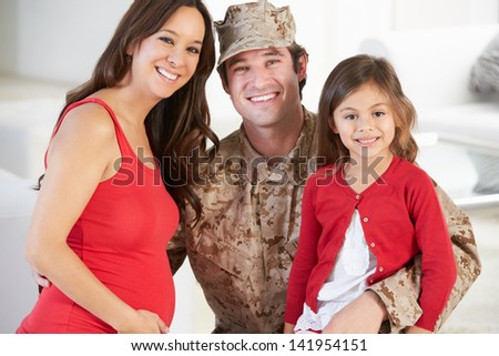Family Greeting Military Father Home On Leave - stock photo