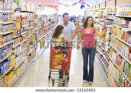 Family grocery shopping in supermarket - stock photo