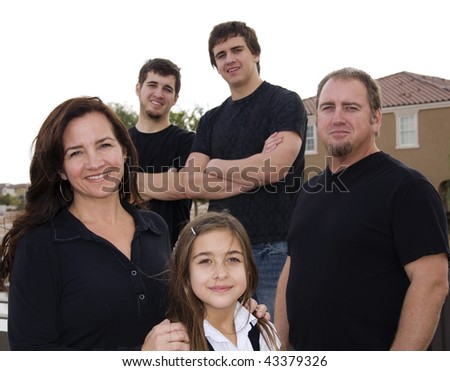 Family group portrait consisting of mom and dad, two boys and a girl - stock photo