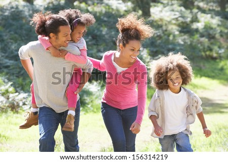 Family Group Walking In Countryside - stock photo