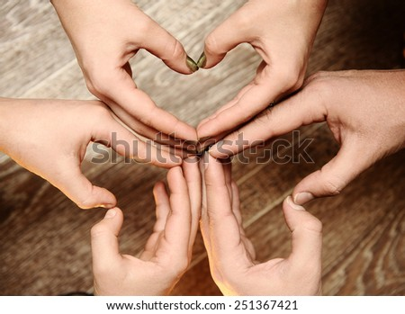 family hands,  symbol of unity. - stock photo