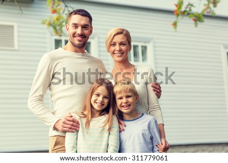 family, happiness, generation, home and people concept - happy family standing in front of house outdoors - stock photo