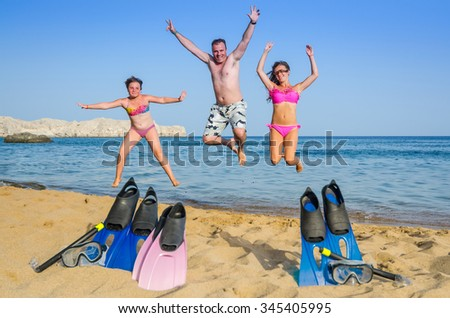 Family happiness on tropical beach - stock photo