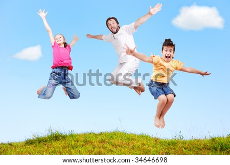 Family happiness outdoor in beautiful natural scene - stock photo