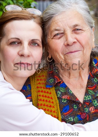 Family - happy daughter and senior mother - stock photo