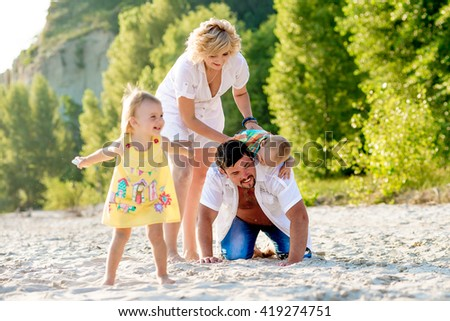 Family happy to rest on the beach summer beach. Mom, Dad and kids fun walk on the beach in summer. - stock photo
