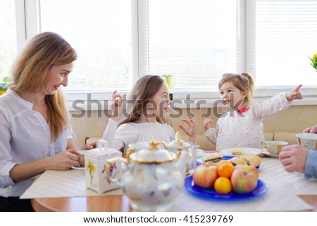 family has breakfast in the morning - stock photo