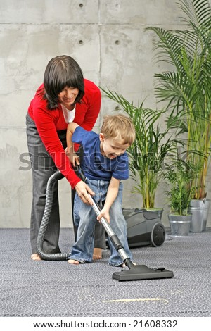 family have fun with cleaning carper - housework
