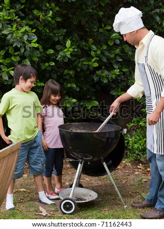 Family  having a barbecue in the garden