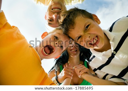 Family having a whole lot of fun - a metaphor for family love, support, and unity (focus on the boy in front!) - stock photo
