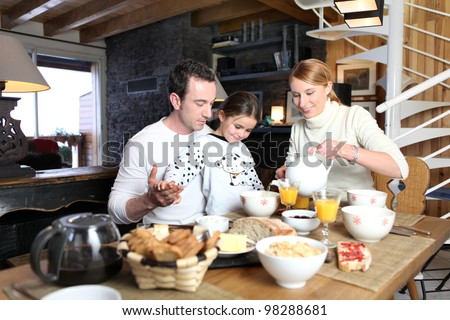 Family having breakfast - stock photo