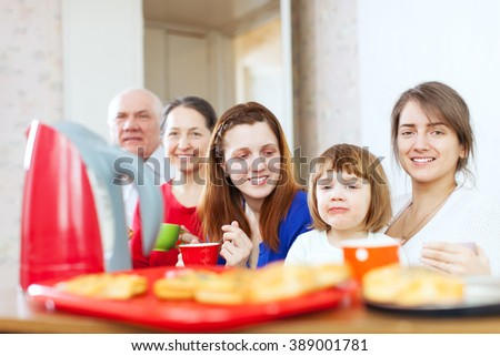 family having breakfast at home together