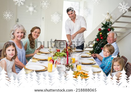 Family having Christmas meal at dining table against fir tree forest and snowflakes - stock photo