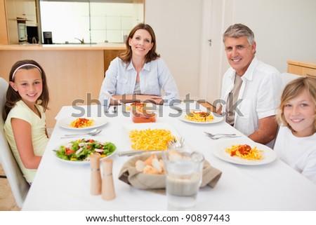 Family having dinner together - stock photo